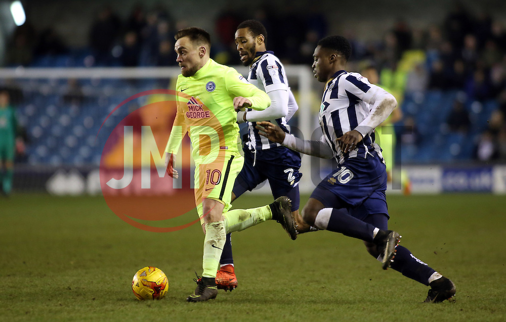 Paul Taylor of Peterborough United is tracked by Shaun Cummings and Fred Onyedinma of Millwall - Mandatory by-line: Joe Dent/JMP - 28/02/2017 - FOOTBALL - The Den - London, England - Millwall v Peterborough United - Sky Bet League One