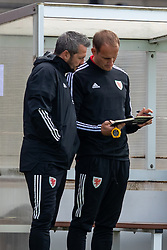 NEWPORT, WALES - Friday, September 3, 2021: Wales' head coach Matty Jones (L) and FAW Trust Technical Director David Adams during an International Friendly Challenge match between Wales Under-18's and England Under-18's at Spytty Park. (Pic by David Rawcliffe/Propaganda)