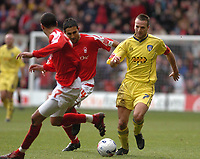 Photo: Leigh Quinnell.<br /> Nottingham Forest v Colchester United. Coca Cola League 1. 08/04/2006. Colchesters Karl Duguid looks for a way past Forests  Jack Lester and  James Perch.
