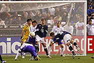 10 February 2006: US forward Taylor Twellman (right) dives to put his header into the net in the second half to give the US a 3-0 lead. The United States Men's National Team defeated Japan 3-2 at SBC Park in San Francisco, California in an International Friendly soccer match.