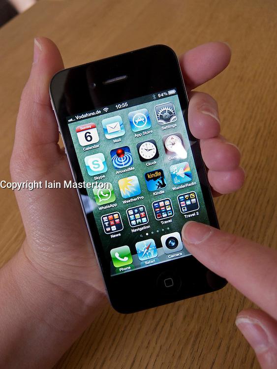 Woman holding an Apple iphone 4G smart phone