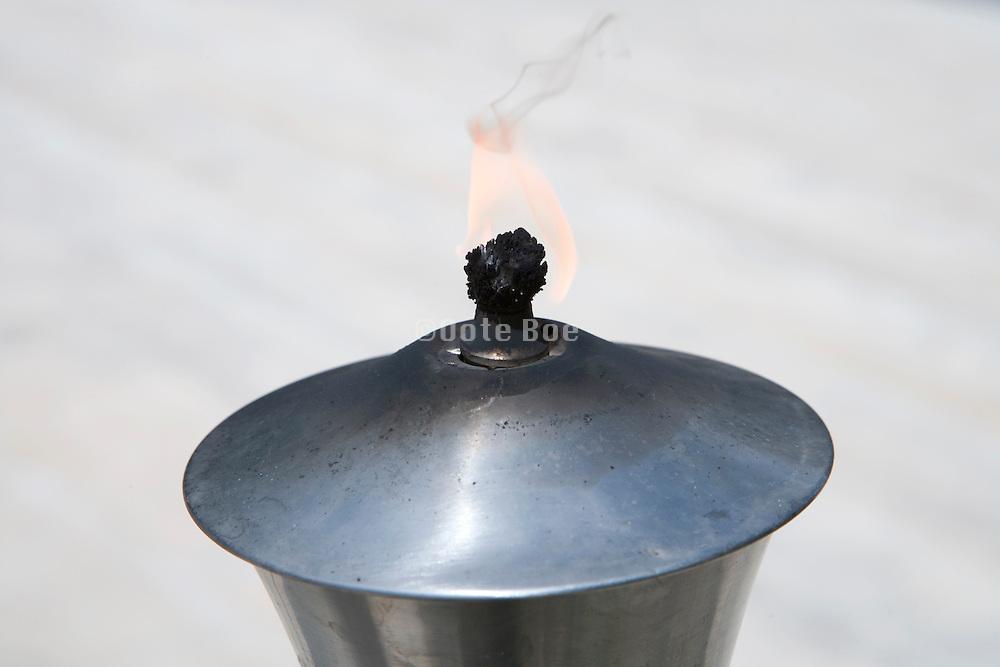 torch burning during daytime