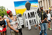 People from across the country participate in  The March for Jobs and Justice in Washington, District of Columbia, U.S., on Wednesday, Aug. 28, 2013, as part of the Let Freedom Ring Commemoration celebrating the 50th anniversary of Dr. Martin Luther King Jr.s' I have a Dream Speech. Photographer: Pete Marovich/Bloomberg