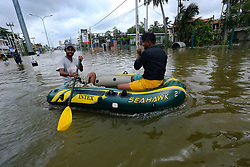 Sri Lankan men use a boat as a mode of transportation to travel across the southern expressway at Godagama, Matara southern part of Sri Lanka on 30 Tuesday May 2017. (Photo by Tharaka Basnayaka/NurPhoto) *** Please Use Credit from Credit Field ***