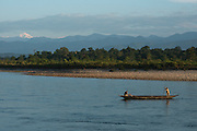 Canoe & Park Guard<br /> Jai Bhoralli River & Mount Gorichand<br /> Nameri Wildlife Reserve<br /> Assam<br /> North East India