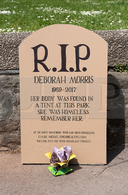 """© Licensed to London News Pictures. 15/05/2019. Bristol, UK. A tribute to a homeless woman who died in 2017 has been left in Castle Park in the city centre. The model headstone is for Deborah Morris who was found dead in a tent in the park on 28 May 2017 aged 48. She had been living in a high-support hostel for 10 months before her death. The cause of her death was not found. The tribute reads: """"R.I.P Deborah Morris. 1969 - 2017. """"Her body was found in a tent at this park. She was homeless. Remember her."""" There is also a message that if anyone knows someone homeless who has died to contact former Bristol Live journalist Michael Yong or the Dying Homeless Project. 17 homeless people died in Bristol in 2017, the same year as Deborah Morris, which accounted for approximately a third of homeless deaths across the entire of the South West. Bristol also had the third highest number of deaths in England and Wales, alongside Lambeth and Liverpool, according to the Office for National Statistics (ONS). Photo credit: Simon Chapman/LNP"""