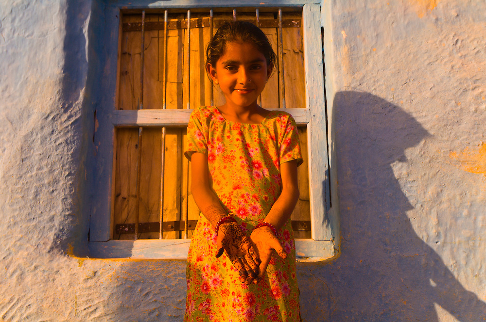 A girl in a Bishnoi tribal village with Mehndi (henna hand painting), near Rohet, Rajasthan, India