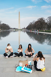 Tourists taking photos in front of the Washington Monument on the National Mall in Washington DC in the United States. From a series of travel photos in the United States. Photo date: Thursday, March 29, 2018. Photo credit should read: Richard Gray/EMPICS