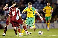 Photo: Paul Greenwood.<br />Burnley v Norwich City. Coca Cola Championship. 17/04/2007.<br />Norwich's Michael Spillane, (R) gets the better of Wade Elliott (L) and Eric Djemba Djemba