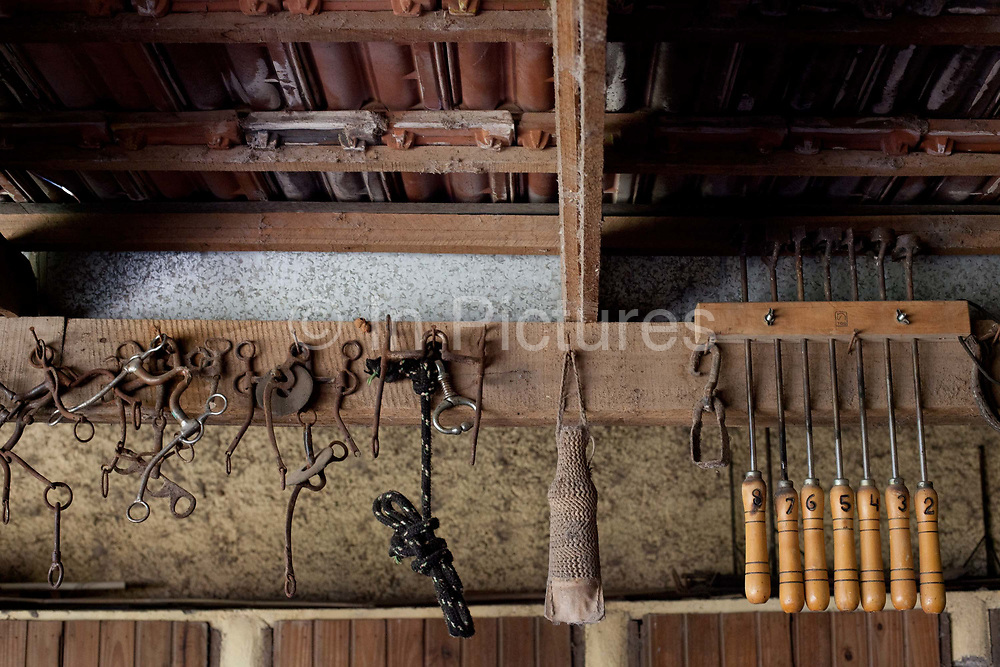 Detail shot of various horse related tools and equipment, in the stables. Working Gaucho Fazenda in Rio Grande do Sul, Brazil.