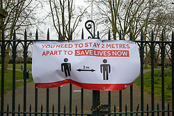 © Licensed to London News Pictures. 01/04/2020. London, UK. A 'YOU NEED TO STAY 2 METERS APART TO SAVE LIVES NOW' banner at the entrance of a north London park  as coronavirus lockdown continues. Photo credit: Dinendra Haria/LNP