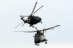 © Licensed to London News Pictures. 26/04/2016. RNAS Yeovilton, Somerset, UK.  Royal Navy Merlin helicopters of the Commando Helicopter Force perform a role demo in front of families of pilots who have recieved their wings.  Photo credit: Jason Bryant /LNP