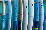 Stack of surf boards at rental shop at Poipu Beach in Kauai, Hawaii, USA
