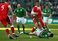 Photo: Paul Thomas.<br /> Republic of Ireland v Wales. European Championships 2008 Qualifying. 24/03/2007.<br /> <br /> Robbie Keane (Ground) of Ireland colides with Carl Robinson (9) of Wales.