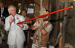 The Prince of Wales reacts after blowing a dart during a visit to the Sarawak Cultural Village, where visitors are encouraged to learn through engaging with culture in Kuching, Sarawak, Malaysia.