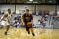 16 December 2006: Jason Vismantas dribbles over the 3 point line with Darius Gant keeping a close eye. The University of Chicago Maroons upset  the Illinois Wesleyan Titans 64 - 60 at the Shirk Center in Bloomington Illinois.<br />