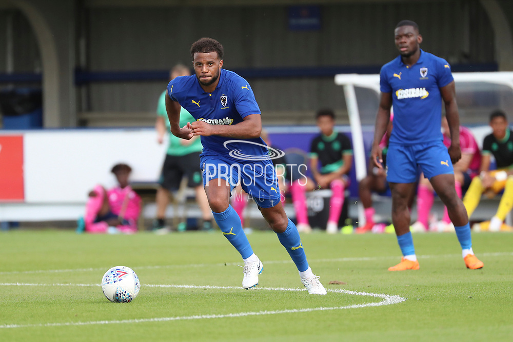 AFC Wimbledon midfielder Tom Soares (19) dribbling during the Pre-Season Friendly match between AFC Wimbledon and Queens Park Rangers at the Cherry Red Records Stadium, Kingston, England on 14 July 2018. Picture by Matthew Redman.