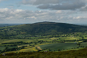 View from Titterstone Clee Hill looking towards Brown Clee Hill on 10th May 2021 in Titterstone Clee Hill, near Ludlow, Shropshire, United Kingdom. Titterstone Clee Hill, sometimes referred to as Titterstone Clee or, incorrectly, Clee Hill, is a prominent hill in the rural English county of Shropshire, rising at the summit to 533 metres above sea level. It is one of the Clee Hills, in the Shropshire Hills Area of Outstanding Natural Beauty.