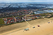 Nederland, Zuid-Holland, Gemeente Westland,  22-05-2011; Noordzeestrand en kust bij Ter Heijde. Op het tweede plan, achter de slaperdijk, Monster en de kassen van het Westland..Omdat de kustverdediging tot voor kort uit slechts een duinenrij bestond was dit een van de Zwakke Schakels van de Kust. De duinenrij is inmiddels verstrekt door aan de zeezijde door middel van zandsuppletie een zanddijk aan te leggen. Deze zanddijk is inmiddels beplant met helm. .North sea beach at Ter Heijde. .This coastline was know as one of the 'weak links' in the coastal defense because the dunes were only one row thick and not very strong. The coast has been  strengthened by means of sand supplementation, creating a sand dike before the dunes. This dike has been planted with marram grass.luchtfoto (toeslag), aerial photo (additional fee required).copyright foto/photo Siebe Swart