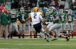 18 October 2014:  Connor Klein reaches for Sam Frasco as he laterals the ball out to a back during an NCAA division 3 football game between the Augustana Vikings and the Illinois Wesleyan Titans in Tucci Stadium on Wilder Field, Bloomington IL