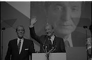 Fianna Fáil Ard Fheis.  (R97)..1989..25.02.1989..02.25.1989..25th February 1989..The Fianna Fáil Ard Fheis was held today at the RDS Main Hall, Ballsbridge, Dublin. An Taoiseach, Charles Haughey TD,gave the keynote speech of the event...An Taoiseach, Charles Haughey TD, is pictured as he takes place at the podium, he is accompanied by An Tanaiste, Brian Lenihan.
