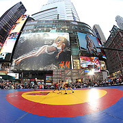 Nahsho Garrett, (USA), in action against George Vangelov, (World),  during the 'Beat The Streets' USA Vs The World, International Exhibition Wrestling in Times Square. New York, USA. 7th May 2014. Photo Tim Clayton