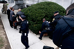 Protestors is apprehended after disturbing the scene as Bill Cosby arrives for a return to Montgomery County Courthouse, in Norristown, PA on April 9, 2018 ahead of the sexual assault retail against the 80 year old actor and comedian.