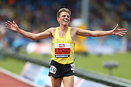 Andrew Butchart celebrates as he wins the Men's 5000 metres race to qualify for the Rio 2016 Olympics. The British Championships 2016, athletics event at the Alexander Stadium in Birmingham, Midlands  on Saturday 25th June 2016.<br /> pic by John Patrick Fletcher, Andrew Orchard sports photography.