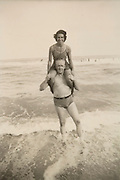 man and woman posing while standing in the surf Florida 1942