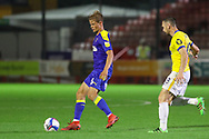 AFC Wimbledon defender Terell Thomas (6) battles with Brighton and Hove Albion midfielder Andrew Crofts (48) during the EFL Trophy Southern Group G match between AFC Wimbledon and Brighton and Hove Albion U21 at The People's Pension Stadium, Crawley, England on 22 September 2020.