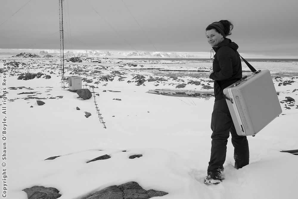 Marissa Goerke heading into the field to take air samples for the NOAA Global Greenhouse Gas Reference Network
