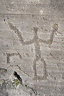 Petroglyph, rock carving, of a schematic warrior holding a shield and a sword. Carved by the ancient Camuni people in the iron age between 1000-1600 BC. Rock no 24,  Foppi di Nadro, Riserva Naturale Incisioni Rupestri di Ceto, Cimbergo e Paspardo, Capo di Ponti, Valcamonica (Val Camonica), Lombardy plain, Italy .<br /> <br /> Visit our PREHISTORY PHOTO COLLECTIONS for more   photos  to download or buy as prints https://funkystock.photoshelter.com/gallery-collection/Prehistoric-Neolithic-Sites-Art-Artefacts-Pictures-Photos/C0000tfxw63zrUT4<br /> If you prefer to buy from our ALAMY PHOTO LIBRARY  Collection visit : https://www.alamy.com/portfolio/paul-williams-funkystock/valcamonica-rock-art.html