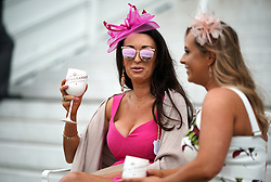 Racegoers enjoy the atmosphere during Ladies Day of the 2019 Invested Derby Festival at Epsom Racecourse, Epsom.