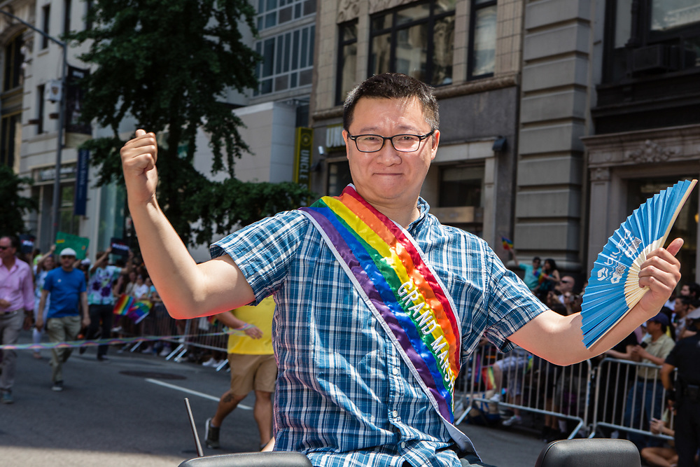 New York, NY - 25 June 2017. New York City Heritage of Pride March filled Fifth Avenue for hours with groups from the LGBT community and it's supporters. Geng Le, founder of the gay dating site Blued, and a Grand Marshall of the march.