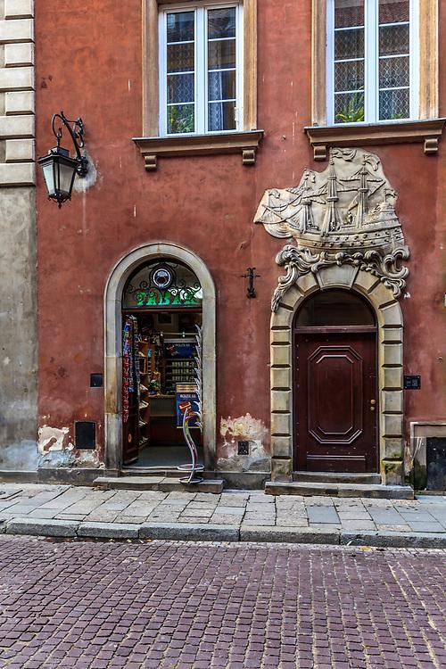 Rococo tenement portal depicts a galleon at Świętojańska Street, in Warsaw, Poland.