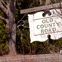 Old County Road sign, a dirt road in Damariscotta, just off of Maine State Road 129.  State Road 129 also known as Bristol Road is the only route to South Bristol and Christmas Cove.