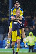 AFC Wimbledon midfielder Mitchell (Mitch) Pinnock (11) carrying AFC Wimbledon midfielder Anthony Wordsworth (40) on his shoulders during the EFL Sky Bet League 1 match between Southend United and AFC Wimbledon at Roots Hall, Southend, England on 12 October 2019.