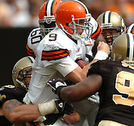 MORNING JOURNAL/DAVID RICHARD.Cleveland quarterback Charlie Frye is sacked by the New Orleans defense yesterday.