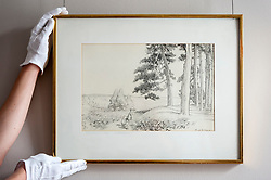 """© Licensed to London News Pictures. 31/05/2018. LONDON, UK. A gallery technician presents """"...an enchanted place on the very top of the forest, 1928, by E.H. Shephard (Est. GBP70,000-90-000), which will be offered for sale at Sotheby's in New Bond Street at the English Literature, History, Science, Children's Books and Illustrations sale on 10 July. A.A. Milne's much loved characters from the Winnie-the-Pooh books inhabited the Hundred Acre Wood.  Photo credit: Stephen Chung/LNP"""