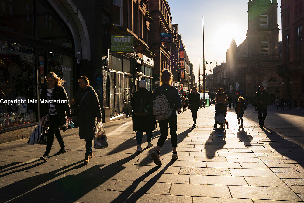Glasgow, Scotland, UK. 19 November 2020. On the day before the highest level 4 lockdown is imposed on west and central Scotland, shops in Glasgow city centre and streets are busy with members of the public. Pictured; Shadows of shoppers on Buchanan Street.  Iain Masterton/Alamy Live News