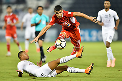 DOHA , Oct. 3, 2018  Pedro Ro-Ro (Bottom) of Al Said SC vies for the ball with Ali Alipour (Top) of Persepolis FC during the AFC Asian Champions League semi-finals first leg football match between Qatar's Al Sadd and Iran's Persepolis FC at Jassim Bin Hamad Stadium in Doha, Capital of Qatar, Oct. 02, 2018. Persepolis FC won 1-0. (Credit Image: © Nikku/Xinhua via ZUMA Wire)