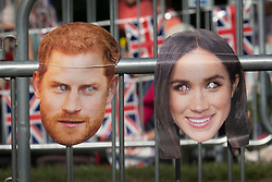 © Licensed to London News Pictures. 19/05/2018. Windsor, UK. Face masks depicting the Royal couple are places on crowd barriers on the Long Walk before the arrival of The Duke and Duchess of Sussex after their marriage ceremony at Windsor Castle. Photo credit: Peter Macdiarmid/LNP