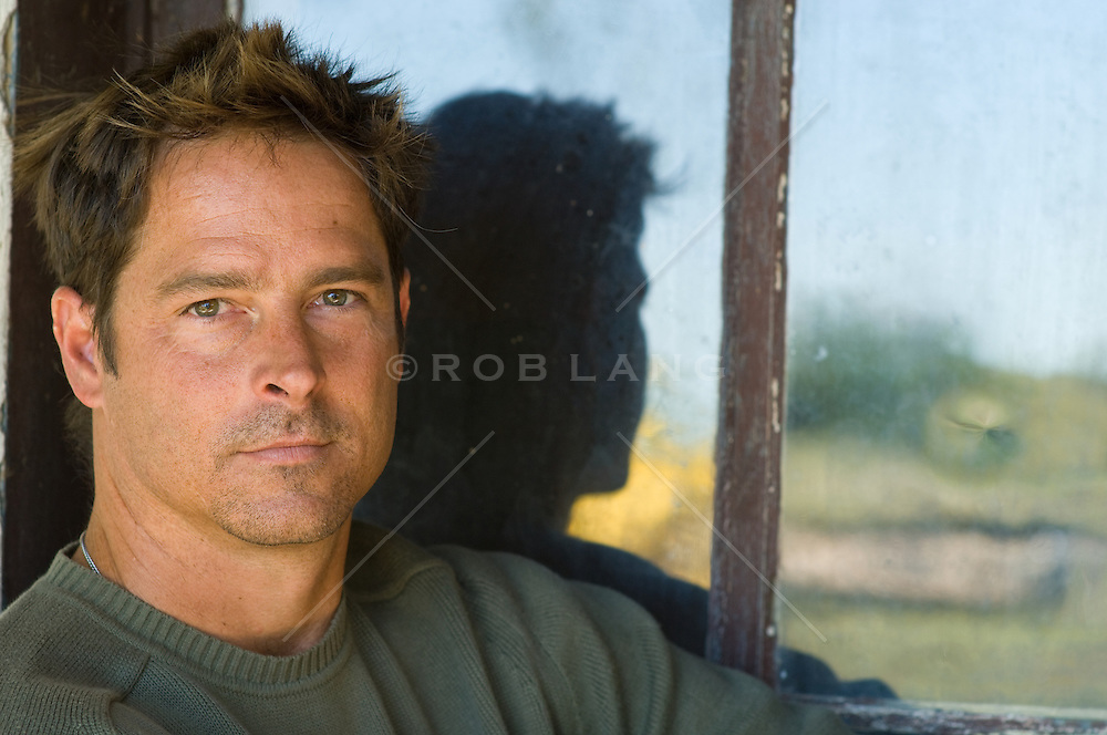 Portrait of a handsome man with hazel eyes and brown hair