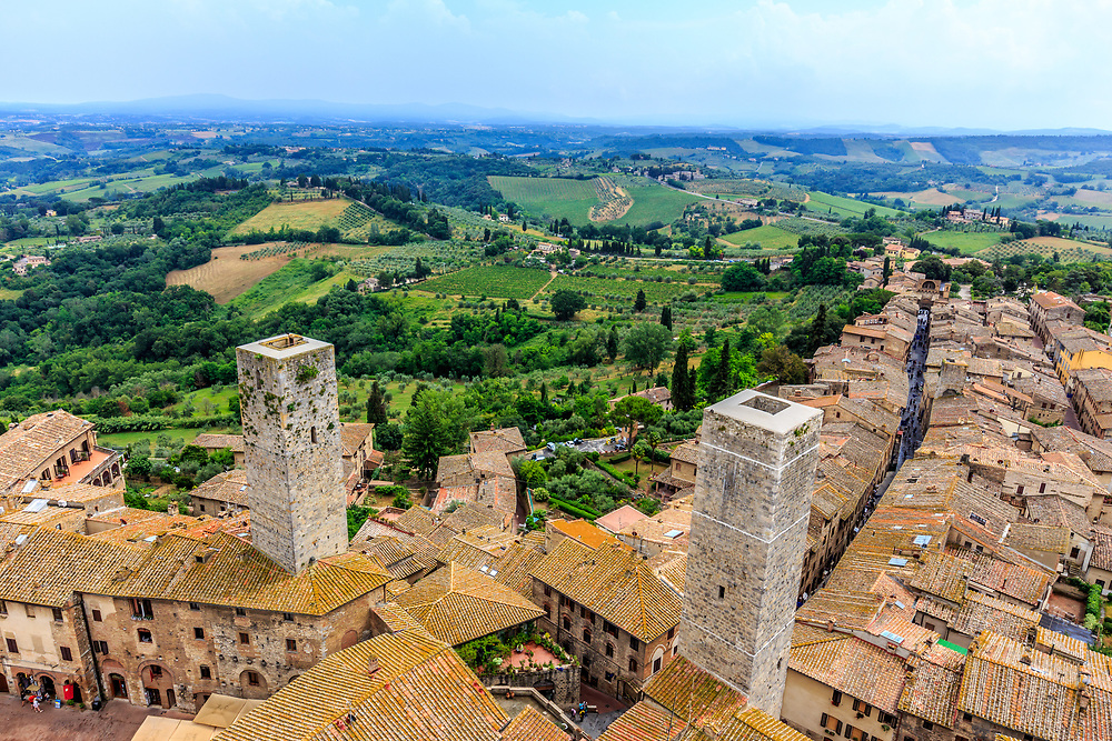 Torri dei Becci (left) and Torri dei Cugnanesi in San Gimignano in Tuscany, Italy.  Known as the Town of Fine Towers, San Gimignano is famous for its medieval architecture, unique in preserving about a dozen of its tower houses, which, with its hilltop setting and encircling walls, form an unforgettable skyline.unforgettable skyline.