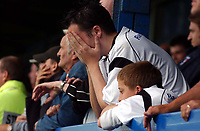 Photo: Olly Greenwood.<br />Colchester United v Derby County. Coca Cola Championship. 26/08/2006. A dejected Derby County fan after losing 4-3