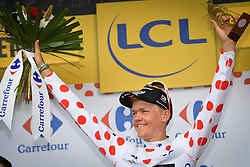 July 14, 2018 - Amiens Metropole, FRANCE - Latvian Toms Skujins of Trek-Segafredo celebrates on the podium in the red polka-dot jersey for best climber after the eighth stage of the 105th edition of the Tour de France cycling race, from Dreux to Amiens Metropole (181 km), in France, Saturday 14 July 2018. This year's Tour de France takes place from July 7th to July 29th. BELGA PHOTO DAVID STOCKMAN (Credit Image: © David Stockman/Belga via ZUMA Press)