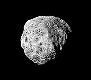 The sponge-like surface of Saturn's moon Hyperion is highlighted in this Cassini portrait.