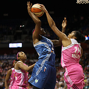 Rebekkah Brunson, Minnesota Lynx, has her shot blocked by Alex Bentley, (right), Connecticut Sun, during the Connecticut Sun Vs Minnesota Lynx, WNBA regular season game at Mohegan Sun Arena, Uncasville, Connecticut, USA. 27th July 2014. Photo Tim Clayton