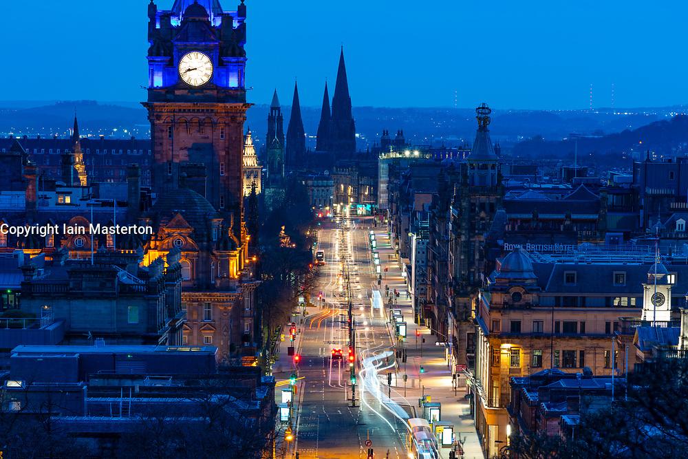 Edinburgh, Scotland, UK. 7 April 2020. Evening view of Princes Street in Edinburgh during the coronavirus lockdown which has dramatically reduced traffic volumes on the street. Long exposure image shows very little traffic. Iain Masterton/Alamy Live News