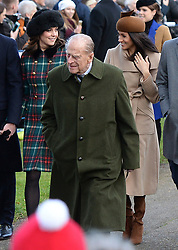 ALTERNATE CROP<br /> (Left-right) The Duchess of Cambridge, the Duke of Edinburgh and Meghan Markle arriving to attend the Christmas Day morning church service at St Mary Magdalene Church in Sandringham, Norfolk.